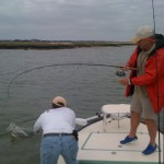 Landing his first redfish